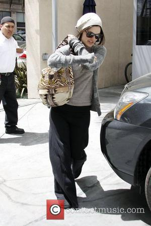 Rachel Bilson stops by at a friend's place in Hollywood. Rachel is back in sunny California after spending some time...