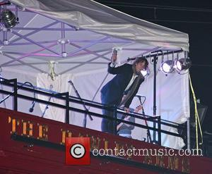 Johnny Borrell of Razorlight performs a secret pre-tour gig on the rooftop of The Hawley Arms in Camden Town London,...