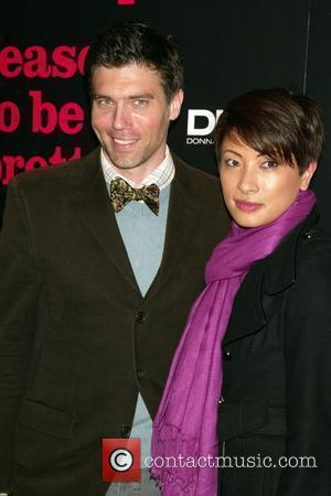 Anson Mount and Guest  Opening Night of the Broadway play 'Reasons To Be Pretty' at the Lyceum Theatre-Arrivals...