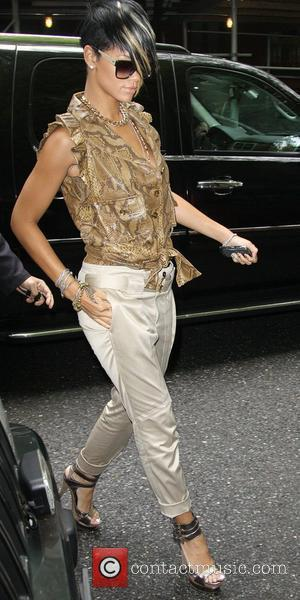 Rihanna, Wearing A Brown Snakeskin Top, Strappy High Heels and Arrives Back At Her Hotel