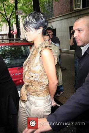 Rihanna, Wearing A Brown Snakeskin Top, Strappy High Heels and Leaves Her Manhattan Hotel