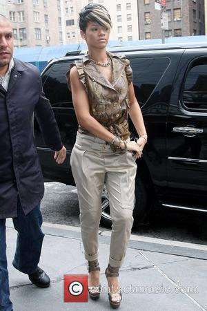 Rihanna, Wearing A Brown Snakeskin Top, Strappy High Heels and Arrives At The Metropolitan Tower In Midtown Manhattan