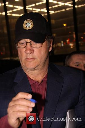 James Belushi signing autographs outside Ritz Carlton Hotel. Belushi is in town to shoot the movie The Ghost with Roman...