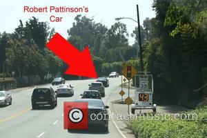 Robert Pattinson in his black Audi driving to actor/director's Peter Berg home, with the paparazzi following close behind him.