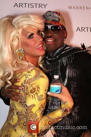 Elaine Lancaster and Dennis Rodman After hours red carpet event Rock Fashion week held Liv night club Miami Beach, Florida...
