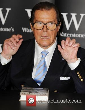 Roger Moore  signs copies of his book 'Roger Moore: My Word is My Bond' London, England - 15.10.08