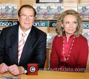 Roger Moore and wife Christina 'Kiki' Tholstrup at a book signing for 'My Word is My Bond'  Dublin, Ireland...