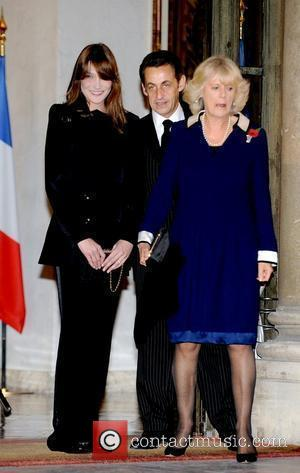Carla Bruni-Sarkozy, President Nicolas Sarkozy, and Camilla, Duchess of Cornwall attend a private dinner, hosted by the French president and...