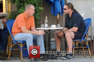 Russell Crowe enjoys coffee and cigarettes with a friend outside Euro cafe Los Angeles, California - 17.10.08