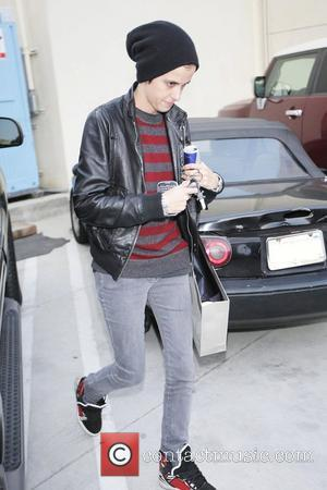 Samantha Ronson carrying a large shopping bag and a Red Bull as she leaves Christian Dior Boutique in Beverly Hills...