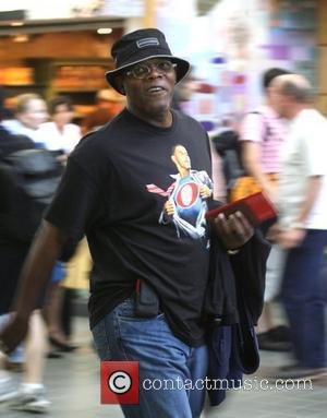 Samuel L. Jackson leaving LAX airport wearing a Barack Obama Superman t shirt, clearly indicating his political stance Los Angeles,...