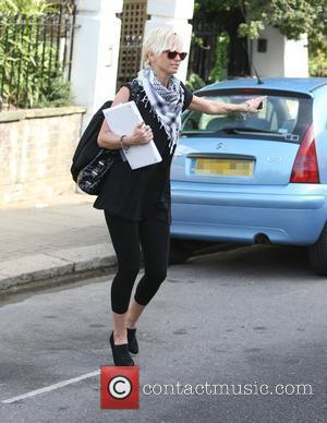 Girls Aloud singer Sarah Harding leaving home wearing a stylish pair of red sunglasses while carrying a laptop London, England...