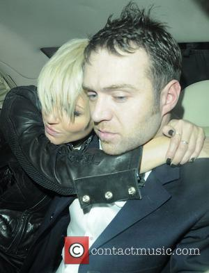 A rather worse for wear Sarah Harding and her boyfriend Tom Crane share a passionate kiss and embrace in the...