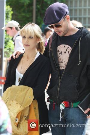 Freddie Prinze Jr walks his wife Sarah Michelle Gellar to the film set of her new HBO series 'The Wonderful...