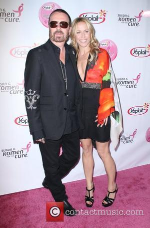 Dave Stewart and Sheryl Crow arrive at the Saves Lives concert in aid of breast cancer awareness Los Angeles, California...