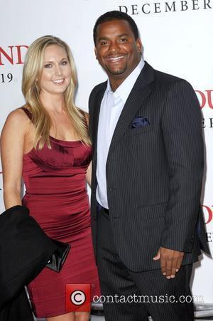 Alfonso Ribeiro and guest Los Angeles Premiere of 'Seven Pounds' held at the Mann Village Theatre Westwood, California - 16.12.08