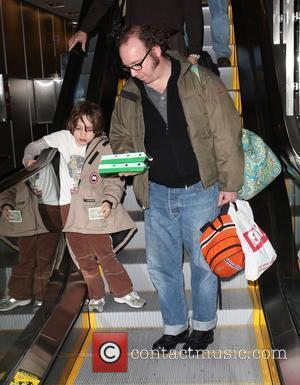 'Cold Souls' star Paul Giamatti, carrying luggage and food from Sbarro, arrives at Salt Lake City airport with his son,...