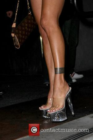 Shauna Sand's high heels former Playboy model Shauna Sand out in Hollywood with a male companion Los Angeles, California -...