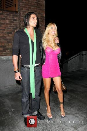 Shauna Sand  former Playboy model out in Hollywood with a male companion Los Angeles, California - 13.04.09