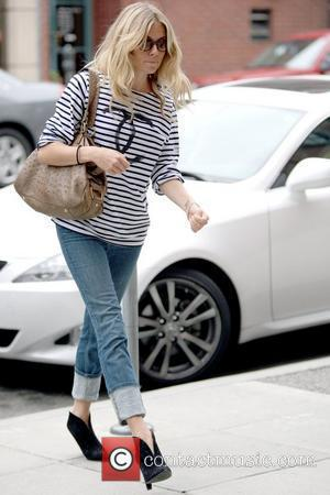 Sienna Miller outside the Anastasia Salon in Beverly Hills Salon wearing rolled up jeans Los Angeles, California - 29.05.09