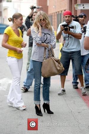 Sienna Miller is swarmed by photographers as she leaves the Anastasia Salon in Beverly Hills Los Angeles, California - 29.05.09