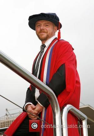 Simon Pegg receives an honorary fellowship from the University of Gloucestershire at a ceremony held at Cheltenham racecourse  Gloucestershire,...