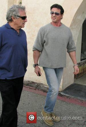 Sylvester Stallone walking to his car with a friend in Beverly Hills. Los Angeles, California, USA - 07.02.09