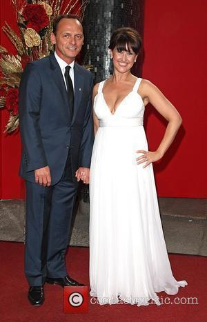 Perry Fenwick and Angela Lonsdale  The British soap awards 2009 held at BBC Television centre - red carpet arrivals...
