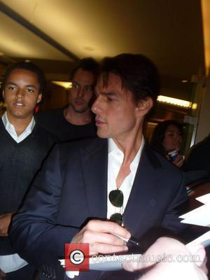 Tom Cruise signs autographs for fans while his son Connor Cruise watches Los Angeles Premiere of 'Star Trek' at Grauman's...