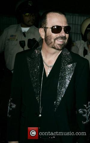 Christian Audigier and Dave Stewart leave the Sunset Marquis Hotel on their way to Dave's concert at Roxy on Sunset....