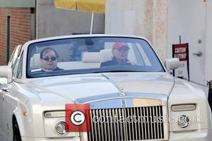 Frederic Prince Von Anhalt pulls up in his new Drop-Top Rolls Royce Phantom Coupe and shows it off to Sylvester...