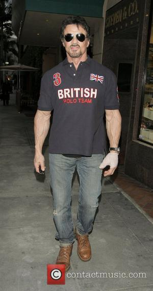 Sylvester Stallone visits a medical building wearing a British Polo Team T- ...