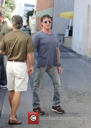 Sylvester Stallone and friends have lunch at Cafe Roma. Sly drives off in a red Ferrari.  Los Angeles, California,...