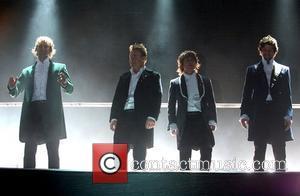Howard Donald, Gary Barlow, Mark Owen, Jason Orange Take That performing at the NEC Birmingham  Birmingham, England - 26.04.06