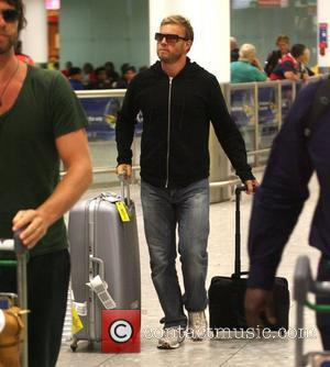 Gary Barlow of Take That arriving at London's Heathrow airport after a night flight from LAX international London, England -...