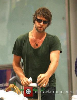 Howard Donald from Take That arriving at London's Heathrow airport after a night flight from LAX international London, England -...