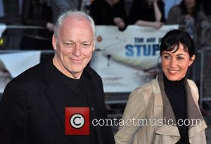 David Gilmour and guest 'The Age of Stupid' UK film premiere held at Leicester Square gardens in a solar powered...