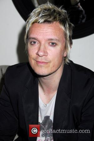 Liam Howlett British electronic music group The Prodigy pose for photographers after an interview in their downtown hotel New York...