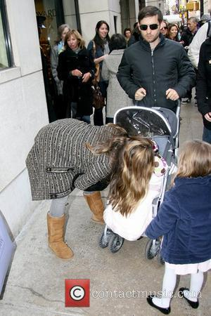 Jennifer Meyer and Tobey Maguire Tobey Maguire pushes a stroller with his daughter Ruby Maguire as they leave Barneys New...