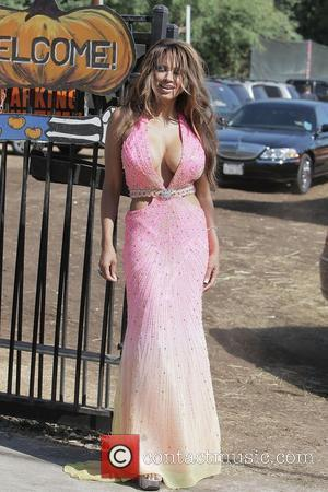 Traci Bingham appears at Mr Bones Pumpkin Patch on Doheney Drive, filming a reality TV show where she is running...