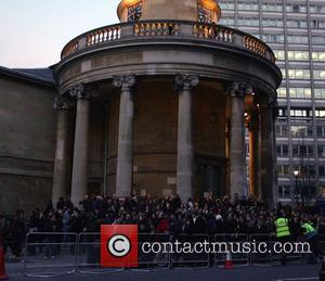 U2 fans wait outside BBC Broadcasting house after the band played an impromptu gig on the roof London, England -...