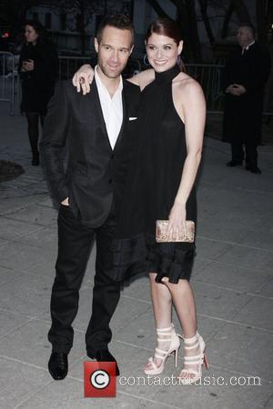 Chris Diamantopoulos and Debra Messing