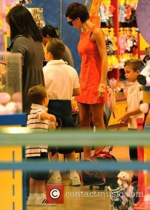 Cruz Beckham and Victoria Beckham