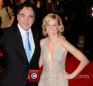 Oliver Stone and Elizabeth Banks