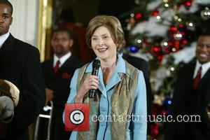 Laura Bush holds the final White House Children's Christmas event in the East Room of the White House welcoming children...
