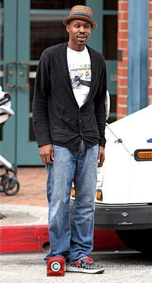 Wood Harris former star of 'The Wire' gives money to a homeless woman while out in Beverly Hills Los Angeles,...