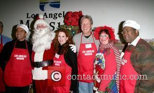 Melissa Gilbert and Bruce Boxleitner Christmas Eve at The Los Angeles Mission Los Angeles, California - 24.12.08