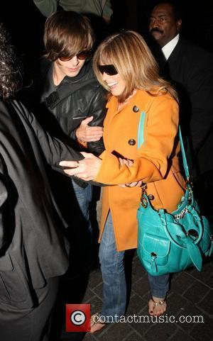 Zac Efron and his mother arrive at LAX on a BA flight from London.