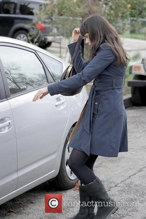 Zooey Deschanel with a splint on her middle finger, leaving M Cafe after eating lunch with a friend Los Angeles,...