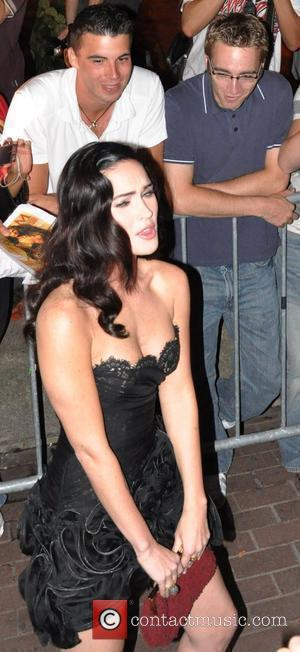 Megan Fox wearing a black Valentino dress at the Jennifer's Body premiere at the Ryerson Theatre during the 2009 Toronto...